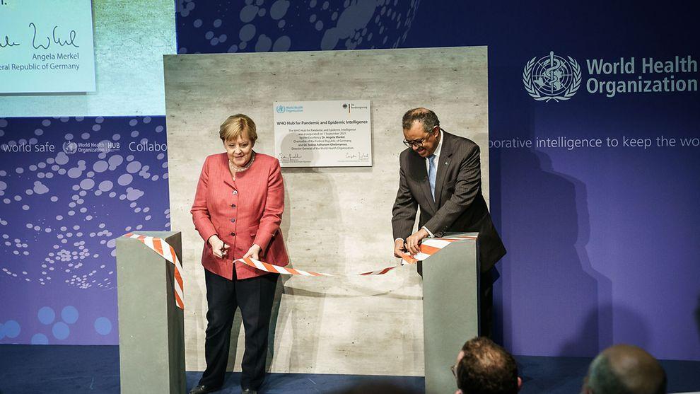 Angela Merkel and Tedros Adhanom Ghebreyesus opening the WHO hub